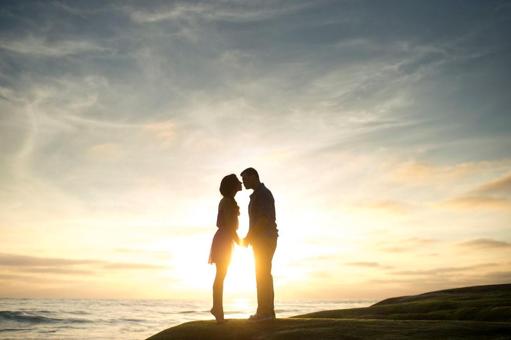 a couple enjoying a sunset at Cocoa Beach