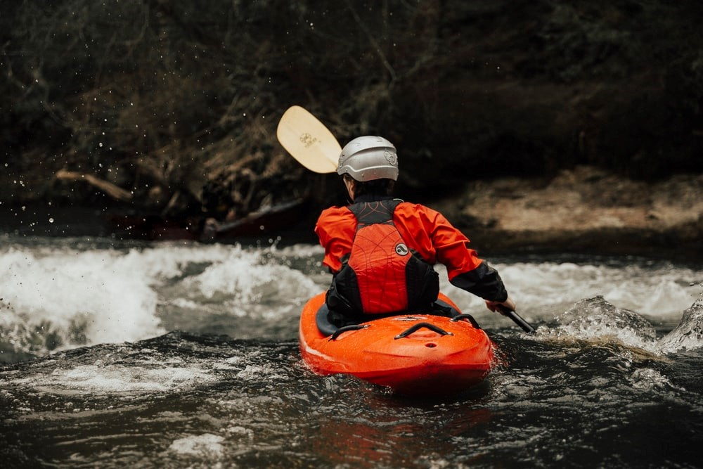 a person kayaking in the water